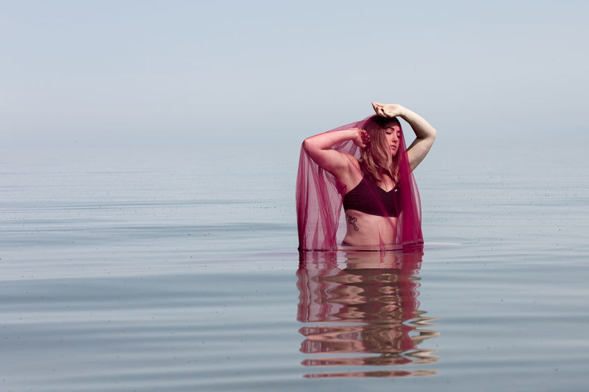 Young Woman Red Color Beautiful Woman Utah The Great Salt Lake Water Sea Sky Close-up Horizon Over Water