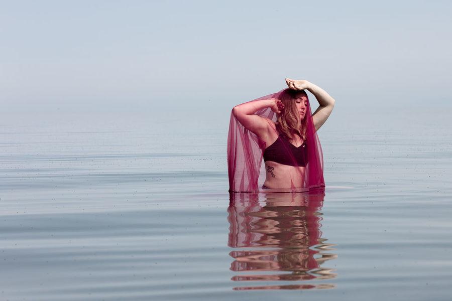 Young Woman Red Color Beautiful Woman Utah The Great Salt Lake Water Sea Sky Close-up Horizon Over Water