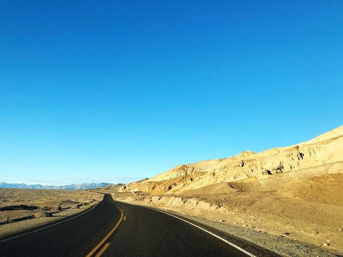 Long drive in a desert 🌵 Travel Destinations Desert EyeEm Selects Sky Clear Sky Blue Copy Space Nature Tranquil Scene Beauty In Nature Scenics - Nature Road Non-urban Scene Landscape Mountain