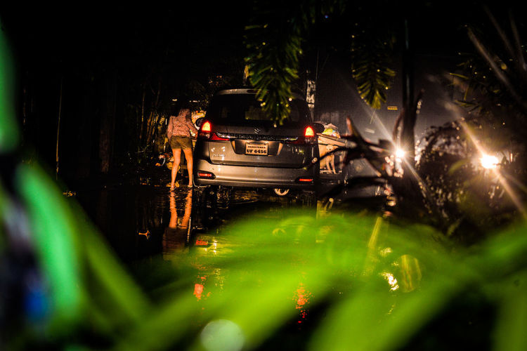 Cars on illuminated field at night