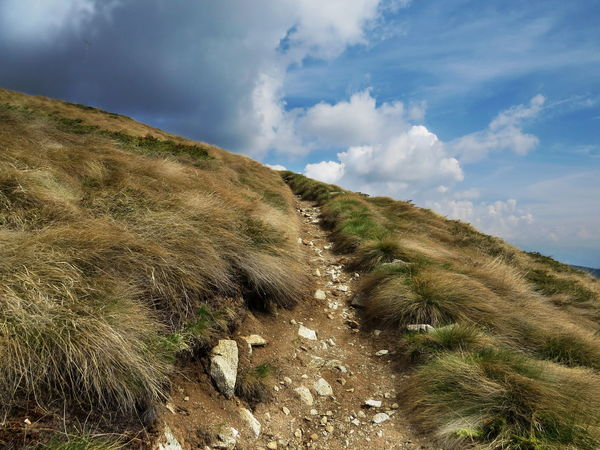 Beauty In Nature Changing Weather Cloud - Sky Day Grass Hiking Trail Landscape Light Contrast Mountain Nature No People Outdoors Path In Nature Scenics Slope The Way Forward An Eye For Travel