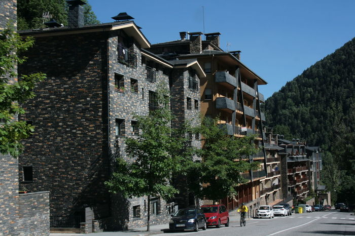 Modern stone houses with green mountains and blue sky on back ground. Andorra Architecture Building Exterior Built Structure Clear Sky Mountain Town Residential Building Ski Resort  Stone Houses  Street