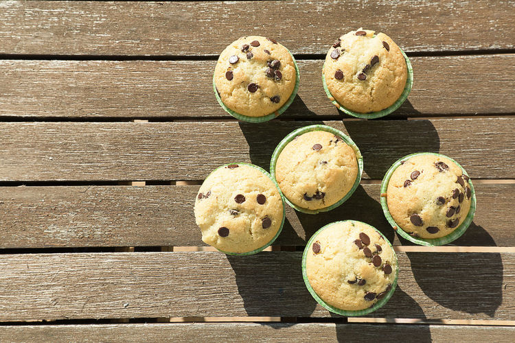 Homemade muffins with natural products. Horizontal shot with natural light. Chocolate Cooking Cupcakes Dessert Diet Food And Drink Homemade Snack Background Brown Cupcake Egg Food Food Photography Group Of The Muffis Healthy Ingredient Muffin Muffins Organic Organic Food Pastry Sweet Table Wooden