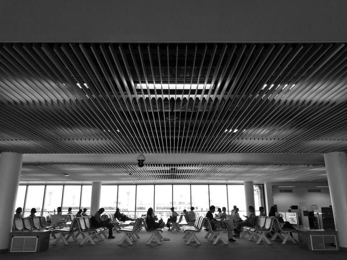 People sitting in modern building