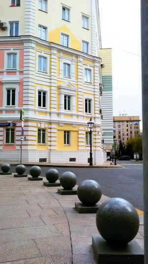 Yellow Building Exterior Architecture Vertical Window City Built Structure Apartment Outdoors No People Day Stone Balls