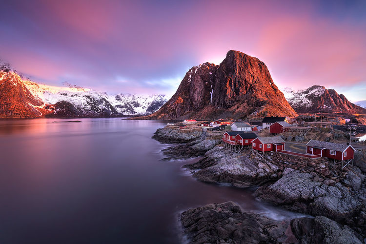 Red beautiful sunrise above Hamnøy, Lofoten islands (Norway). Atlantic Beautiful Nature Norway Scandinavia Arctic Background Europe Fishing Hut Landscape No People North Ocean Outdoors Picturesque Rorbuer Scenery Sea Sky Snow Sunrise Tourism Vilage Water