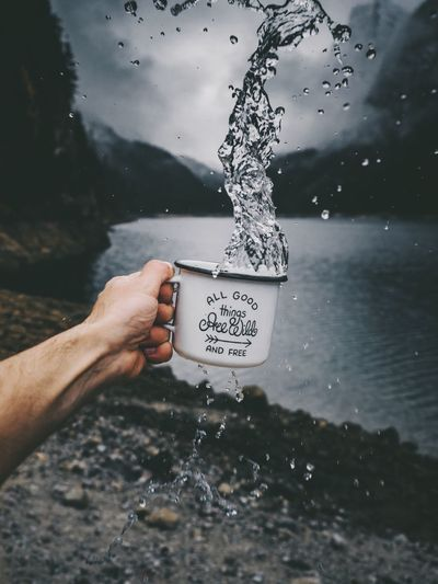 Human Hand Water Human Body Part Holding One Person Real People Text Day Outdoors Close-up Motion Nature Sea Freshness Sky Dripping People