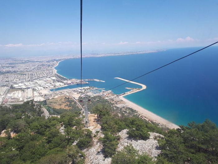 Scenic view of coastline against blue sky