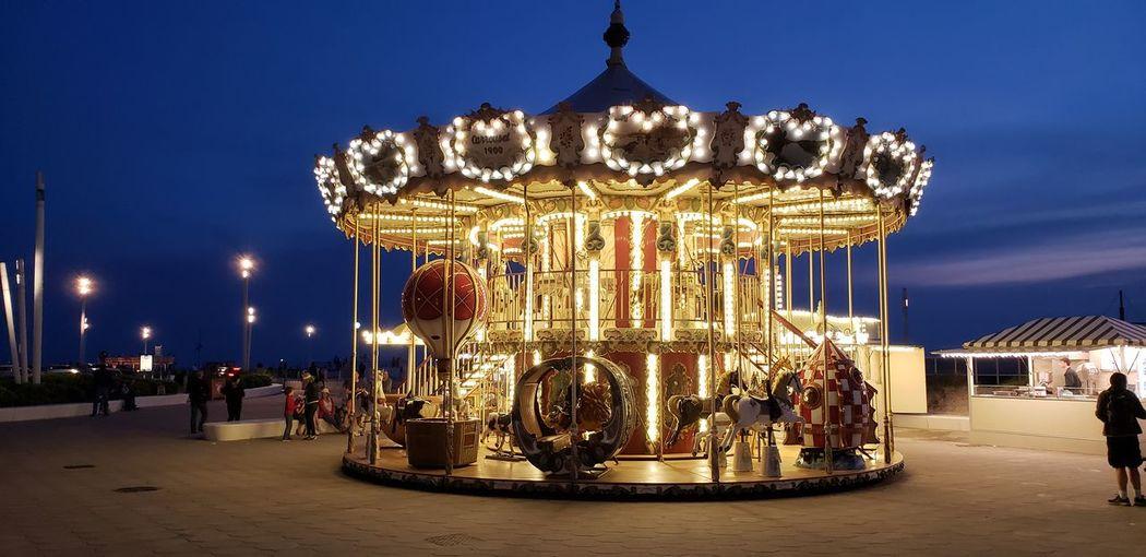 Carousel Merry-go-round Illuminated City Amusement Park Ride Ferris Wheel Beach Arts Culture And Entertainment Amusement Park Summer
