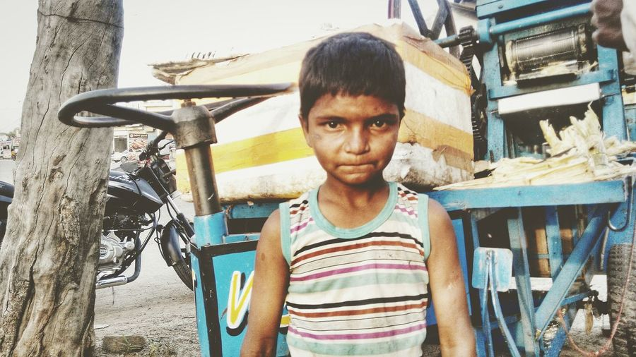 """""""Clean city is my dream city"""". You were busy sipping the soda drink, while """"jeetu"""". Was happy serving us the fresh sugarcane juice and explains. Not child labour but a helper to his family. God bless him.. Capturemoment Childhood Cleancity Taking Photos EyeEm"""