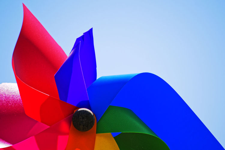 Low Angle View Of Colorful Pinwheel Toy Against Clear Sky