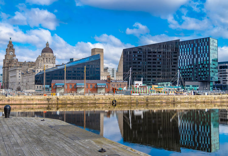 Liverpool Architecture Building Building Exterior Built Structure City Cloud - Sky Day England Merseyside No People Office Building Exterior Outdoors Reflection River Sky Skyscraper Travel Destinations Water Waterfront #urbanana: The Urban Playground EyeEmNewHere A New Beginning British Culture