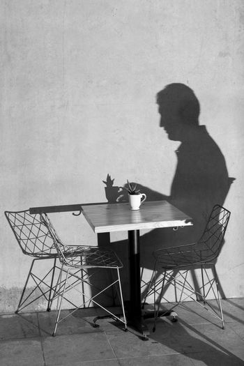 Shadow Of Man On Table