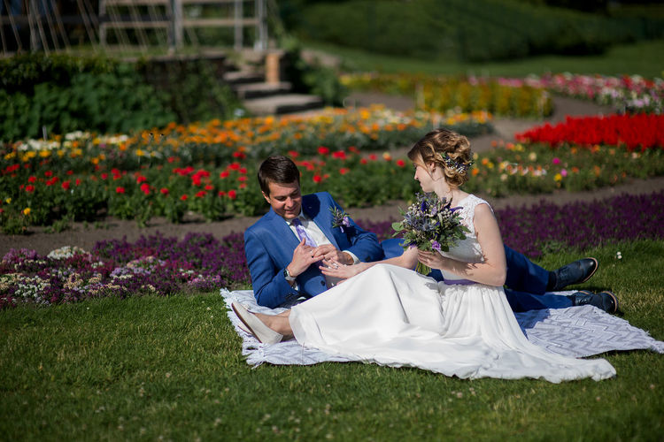Bride And Bridegroom On Picnic Blanket At Park