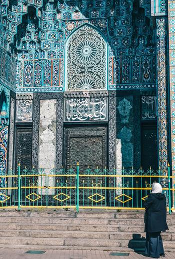 Rear view of man on door of building