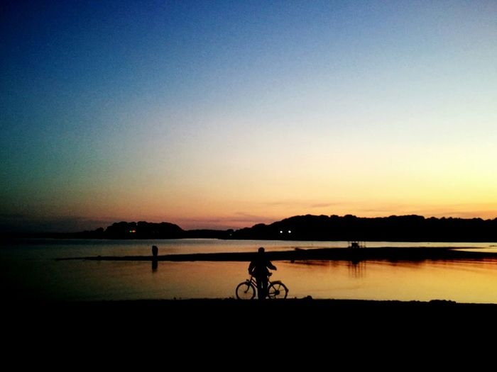 Being passionate about biking means that sometimes you have to get off your bike and just enjoy your surroundings. :-) Silhouette Bicycle Water Sunset Tranquil Scene Scenics Tranquility Clear Sky Non-urban Scene Nature Sea And Sky Seascape Croatia Man And Bike September 2016 SeptemberPhotoChallenge Showcase September Sea Sunset Amazing Sky Sea Sunset Huawei P9 Leica Cellphone Photography People And Places