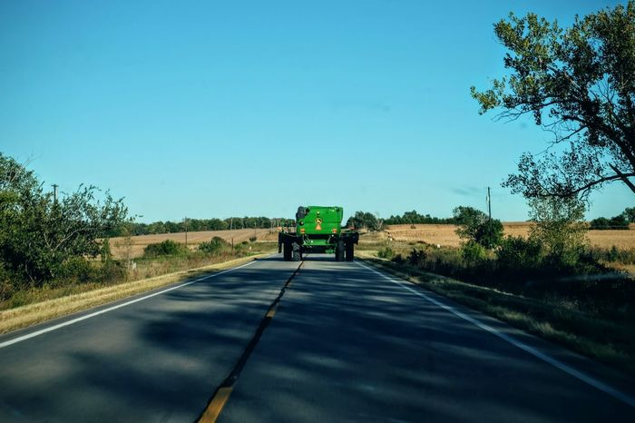 Camera Work - Southeast Nebraska October 2016 Blue Sky Camera Work Colors And Patterns Copy Space Countryside Diminishing Perspective Everyday Lives Eye For Photography EyeEm Best Shots EyeEm Gallery Eyeem School Of Photography EyeEmBestPics Fujifilm Green Color Harvest Time Nebraska Outdoors Photo Essay Photography Road Rural America Selects Small Town The Way Forward Tractor