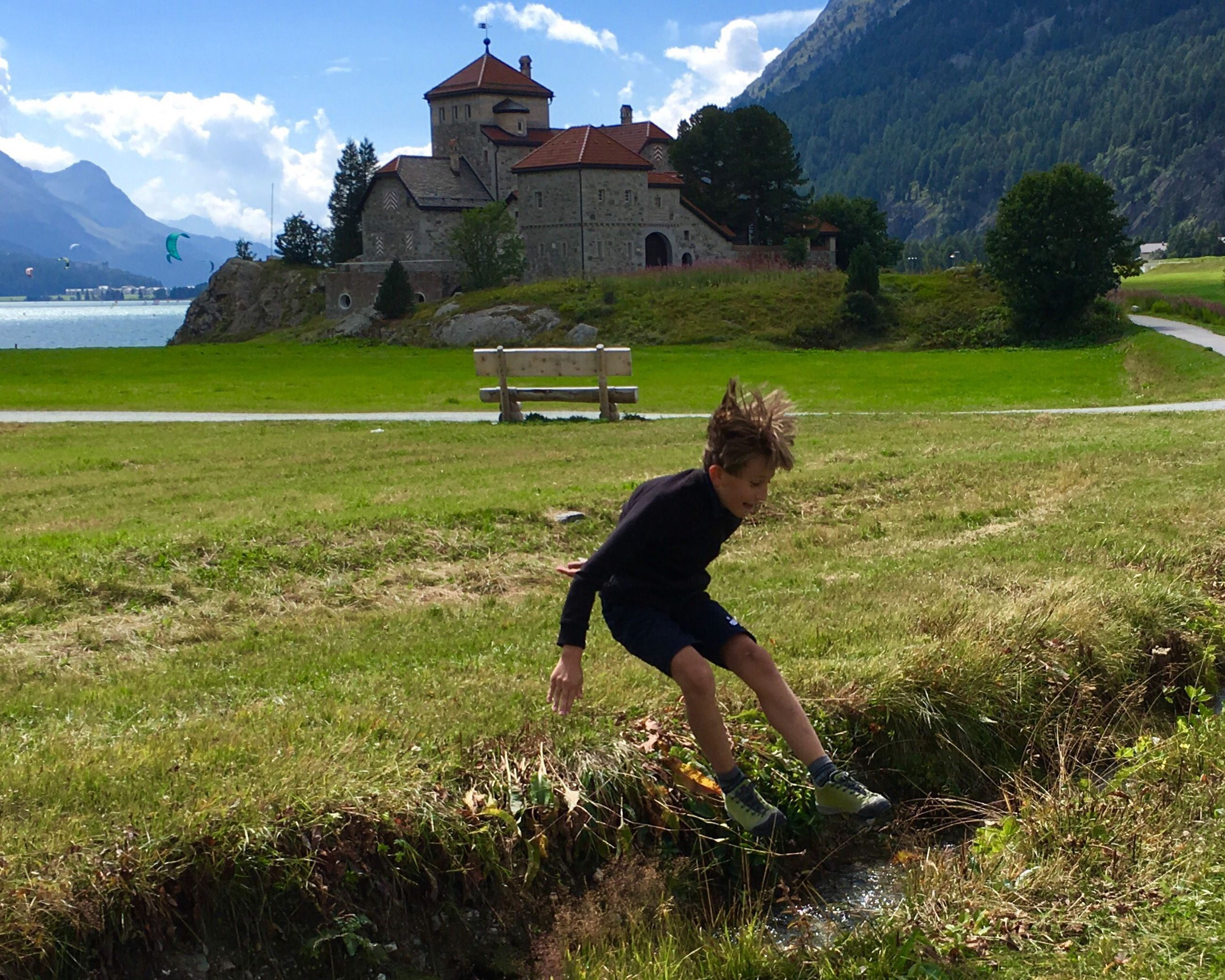 child, grass, childhood, plant, real people, land, building exterior, one person, architecture, nature, field, built structure, boys, day, full length, males, lifestyles, casual clothing, leisure activity, outdoors, innocence