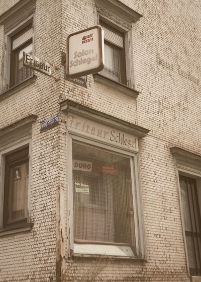 Architecture Brick Wall Building Exterior Built Structure Communication Day Door Exterior Friseursalon Full Frame Historic History Low Angle View No People Non-western Script Old Text Timeless Urban Wall Wella Western Script Window