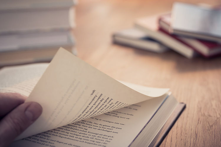 Adult Adults Only Book Books Close-up Communication Exceptional Photographs Things I Like From My Point Of View Hello World Holding Human Body Part Human Hand Indoors  Library One Person Page Paper People Read Reading Reading & Relaxing Reading A Book Table Turning Pages