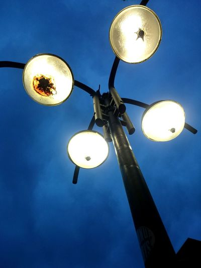 Low angle view of lamp post against sky