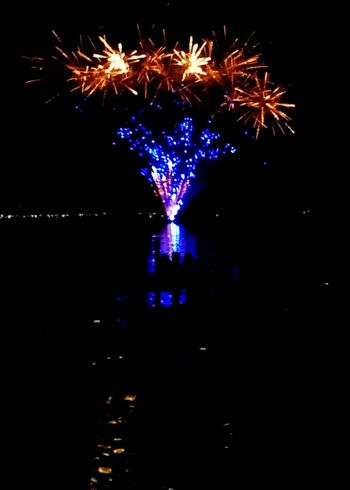 Illuminated Night Celebration Reflection Multi Colored Firework Display Event 4th Of July Entertainment Outdoors Water Glowing Firework Celebration