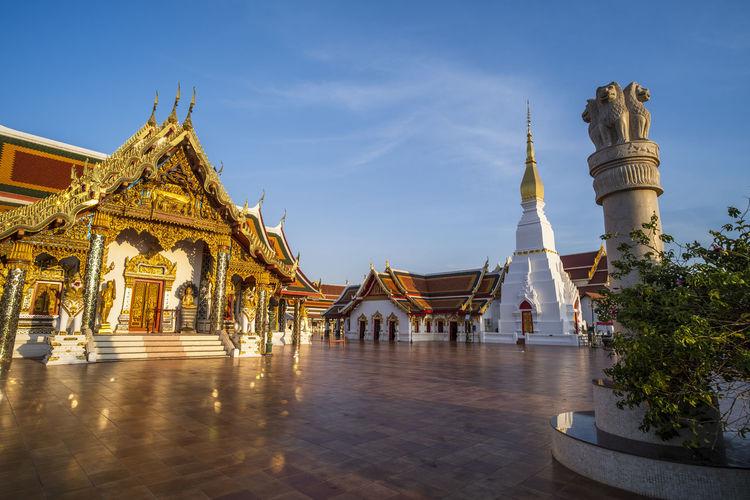 Temple amidst buildings against sky