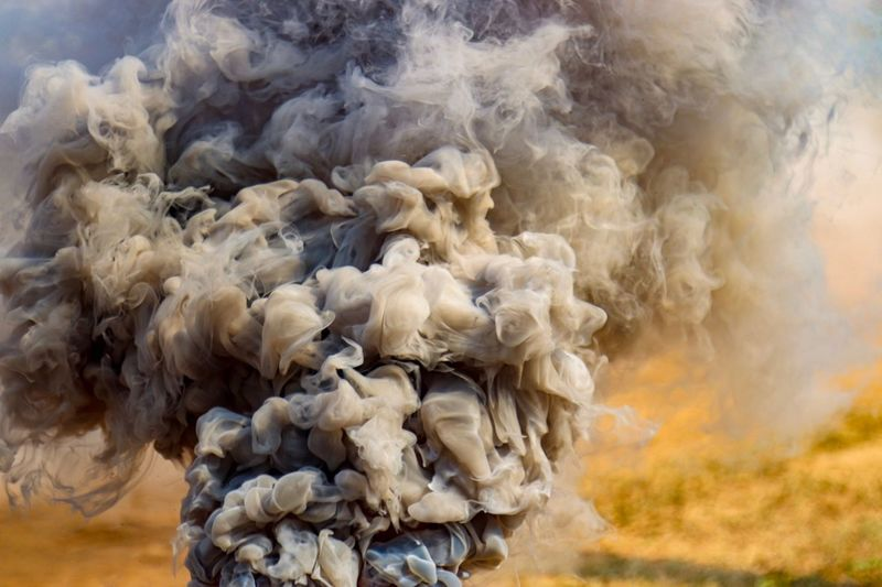 Smoke - Physical Structure Burning Motion Day No People Nature Fire - Natural Phenomenon Communication Fire Warning Sign Close-up Pollution Outdoors Exploding Heat - Temperature Sign Environment Abstract Focus On Foreground Cloud - Sky Smog