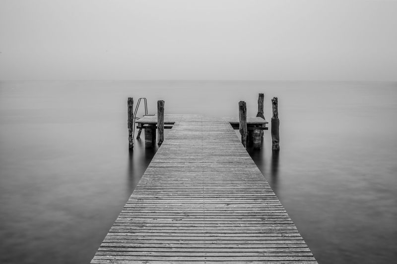 B&W jetty on a lake Blackandwhite Horizon Over Water Italia Italy Jetty Jetty Area Jetty View Lake Lake View Lakescape Lakeside Landscape Longexposure No People Pier Silence Sky Tranquil Scene Water Wood - Material
