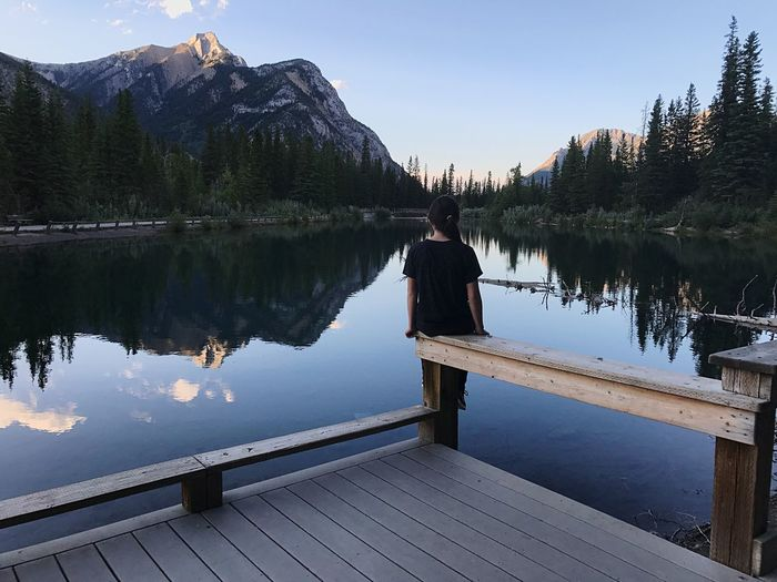 Girl at the lake Canada Girl EyeEm Selects Lake Reflection Water Tranquil Scene Nature Scenics Beauty In Nature Sky One Person Outdoors Mountain Tranquility Standing Mountain Range Clear Sky Day
