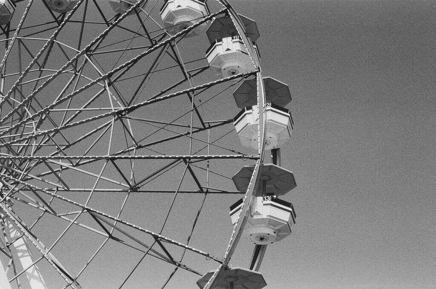 Amusement Park Low Angle View Arts Culture And Entertainment Clear Sky Amusement Park Ride Ferris Wheel Illfordhp5 Black And White Blackandwhite Filmisnotdead Filmphotography Filmcamera 35mm Film Film Photography Film Is Not Dead Film Filmphoto Getting Inspired Eye4photography  Blackandwhitephotography Blackandwhite Photography Black And White Photography Lifestyles Fun Embrace The Sun