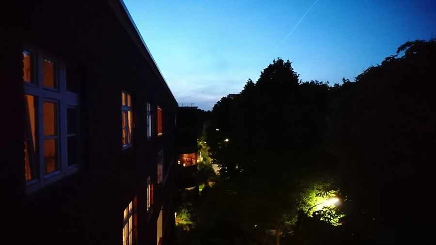 Apartments. · Hamburg Germany Hh 040 Apartments Apartment Block Apartment Buildings View From The Balcony Urban Landscape Cityscape Sunset Summer Night Darkness Urban Life City Life Trees Mystery