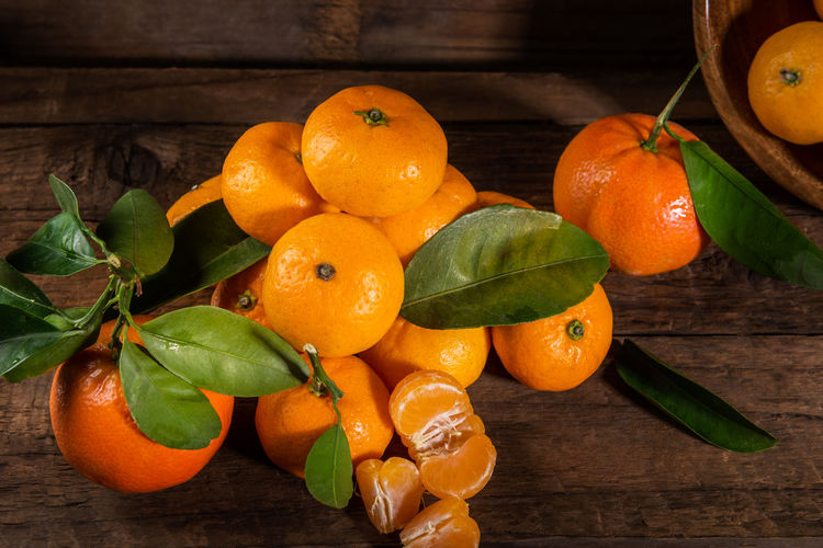 Close-up of orange fruits on table