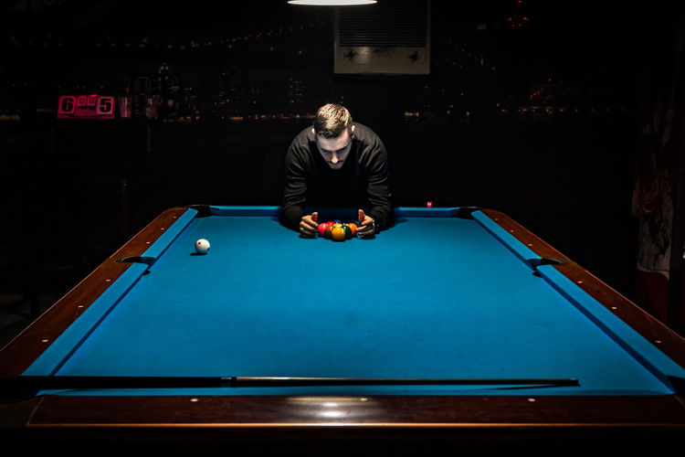 Man playing pool on table