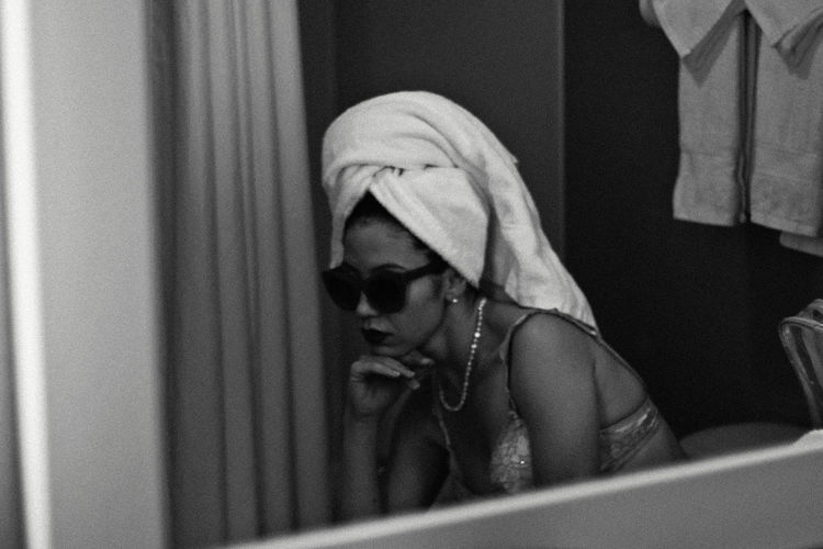 Chicago, 2018 Indoors  One Person Real People Lifestyles Clothing Mirror Reflection Looking Portrait Young Adult Sitting Women Home Interior Domestic Room Adult Headshot Casual Clothing Mid Adult Getting Ready Fashion Retro Towel Sunglasses Black And White Hotel The Portraitist - 2019 EyeEm Awards