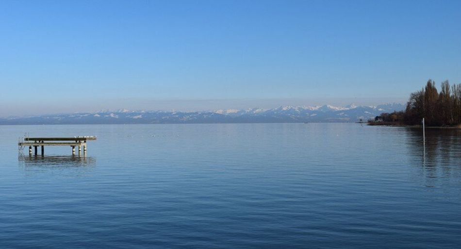 Water Tranquility Clear Sky Blue Nature Lake Scenics Beauty In Nature Tranquil Scene Outdoors Waterfront No People Built Structure Mountain Day Bodensee Sky Bodenseebilder Thurgau