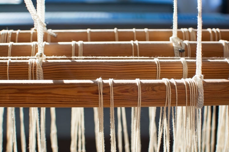 Close-up of hand loom in industry