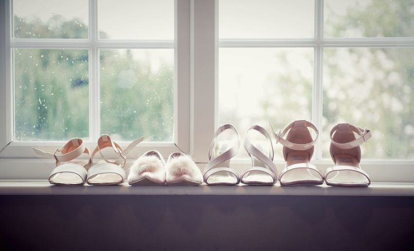 High Heels Arranged On Window Sill