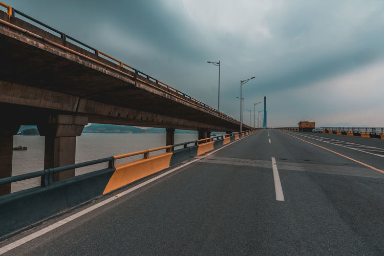 road Transportation Road Sky Bridge Connection Bridge - Man Made Structure Symbol Cloud - Sky Marking Road Marking Built Structure Architecture Direction The Way Forward Nature Sign Street Street Light No People Diminishing Perspective Outdoors Dividing Line Architectural Column