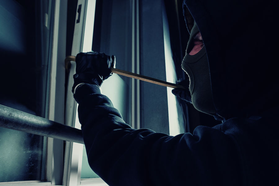 Burglar breaking in to a house Agressive Burglar Burglary Business Close-up Crime Crime Scene Crowbar Finance And Industry Gangster Gloves Hoodie Human Body Part Intruder  Lifestyle Light And Shadow Mask Night One Man Only One Person Police Window