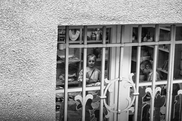 //child playing on afterclass lessonsEmbrace Urban Life Close-up Child Kid Kids Play Nikonphotography Europe Poland Childhood Real People City Urban People Nikon Window The Street Photographer - 2017 EyeEm Awards Place Of Heart Live For The Story