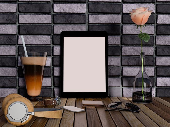 Mock up tablet and devices on table. Drink Table Refreshment Food And Drink Glass No People Technology Drinking Glass Wireless Technology Computer Still Life Indoors  Household Equipment Laptop Connection Plant Wall - Building Feature Freshness Wood - Material Communication Brick