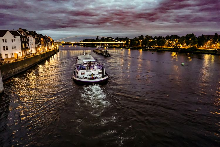 Maastricht Meuse River Nautical Vessel Cloud - Sky Travel Destinations Reflection Outdoors Tourism Sky Vacations No People Water Night Architecture City Maastricht Maastricht By Night Maastricht Holland Seascape Photography Maastricht,NL Seascape Landscape Dramatic Sky Sunset Seascapes Vacations Maastricht NL
