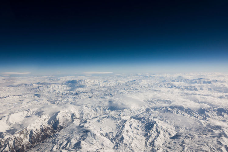 Aerial View Sky Scenics - Nature Blue Environment Nature Planet Earth Landscape Copy Space Beauty In Nature No People Cloud - Sky Snow Tranquil Scene Space Extreme Terrain Tranquility Mountain Outdoors Meteorology Above Climate