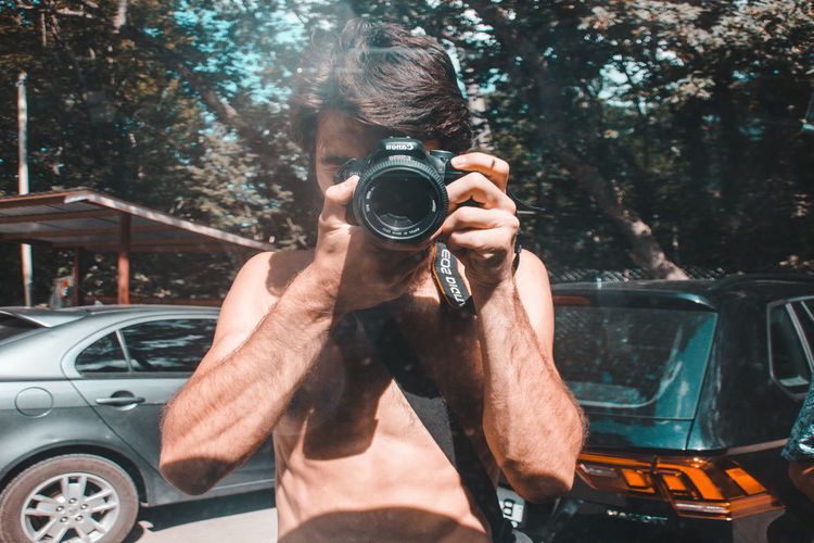 Self-portrait. The man photographed himself in the reflection of the car glass. Activity Adult Camera - Photographic Equipment Car Digital Camera Holding Land Vehicle Men Mode Of Transportation Motor Vehicle Occupation One Person Outdoors People people and places Photograph Photographer Photographic Equipment Photographing Photography Themes Portrait Real People Selfie Technology Transportation