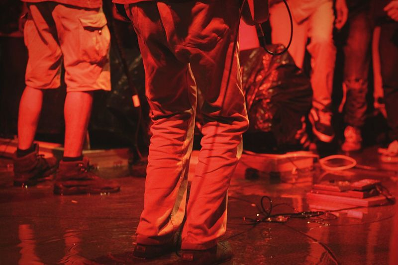 the water also sang Canon Fix50mm Red Color Colors Music Festival INDONESIA Distortion Cable Footpath Bob Marley Reggae Low Section Group Of People Night Performance Music Standing Human Leg Nightlife Stage People Event Stage - Performance Space Men Arts Culture And Entertainment Enjoyment