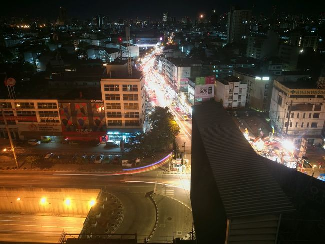 Night Illuminated City City Life Cityscape Outdoors People Skyscraper Building Exterior Architecture Adults Only Only Men Adult Urban Skyline Sky One Person EyeEmNewHere Thailand Tower Buildings Traffic Lights Light City View  Citylights