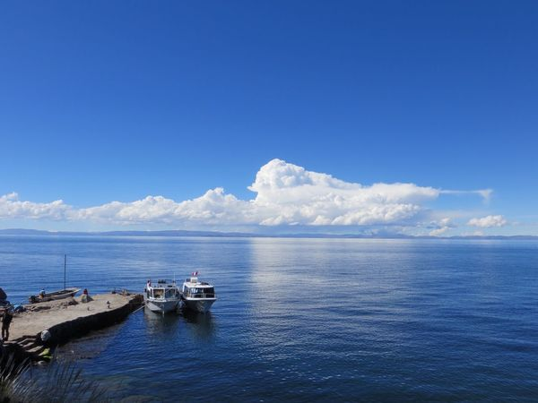 Sea Water Nautical Vessel Nature Scenics Transportation Sky Beauty In Nature Horizon Over Water Blue Tranquility Day Cloud - Sky Outdoors No People Tranquil Scene Mode Of Transport Waterfront Lake Titicaca Amantaní Amantani Island Travel Destinations Peru Blue