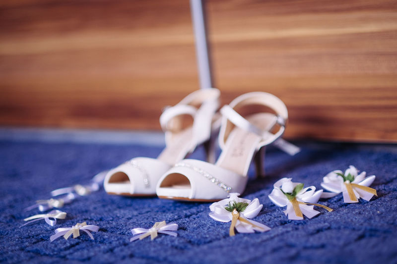 Pair Of High Heels And Ribbon Bows On Blue Carpet