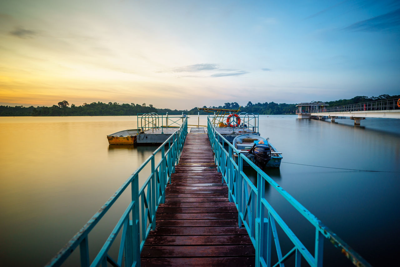 water, pier, sky, built structure, sunset, jetty, nature, cloud - sky, tranquility, outdoors, the way forward, tranquil scene, beauty in nature, architecture, scenics, no people, travel destinations, sea, wood paneling, nautical vessel, building exterior, day